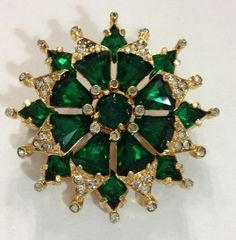 Vintage Eisenberg Brooch, with emerald rhinestones and clear highlights..