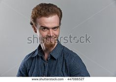 Close up portrait ginger bearded hipster with raise eyebrow
