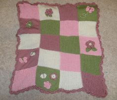 Hand Knit Patch-Work Embellished Baby Blanket Butterflies & Flowers. $75.00, via Etsy.