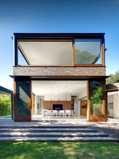 almost square #hugewindows with #slidingdoors, indoors and outdoors combined and a huge #openkitchen area. And also, did I spot a pool? so the only thing missing are huge plants