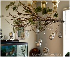 Love the cedar left on the branch. Natural tree branch turned decorative ornament display