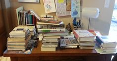 My desk, covered in library books.