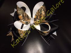 Camouflage boutique bow www.facebook.com/KatiesBowsGalore or send email inquiries to ladiekatie985@gmail.com