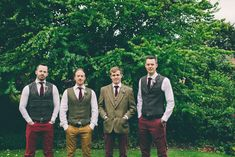Groomsmen reflecting their own style in a Harris Tweed Jacket and burgundy chinos -   Image by  Neil  Jackson Photographic - A wedding in North Yorkshire with the bride in a blush pink vintage gown and the groom in tweed. Marquee wedding with paper flower arch and wild flowers.