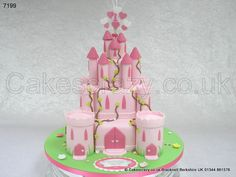 Princess Castle Cake.Your wish can come true.. All pink girly princess castle cake made from three alternating shaped tiers and cake made towers.  Decorated with climbing ivy pink doors and windows, and finished with a number 1 wired heart shaped cake topper and birthday message plaque.