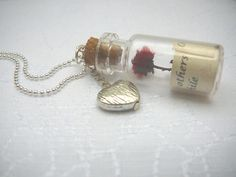 Personalised Necklace, Message in a Bottle, Personalized Quote in Glass Bottle Pendant, Glass Vial, Friendship Gifts. $28,00, via Etsy.