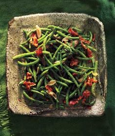 Green Beans With Bacon Vinaigrette|Dress up plain green beans with a warm, tangy bacon-and-shallot dressing for an outstanding side dish.