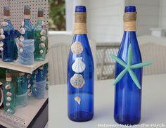 Wine bottle - beach, shell, and starfish beach wedding decorations.
