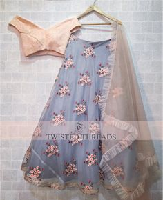 Grey and Peach off shoulder Lehenga Choli Features a banglori silk blouse with chikanakari work alongwith organza lehenga with can can layered.Comes with organza dupatta. Indian Lehenga, Indian Gowns, Indian Attire, Indian Ethnic Wear, Lehenga Choli, Indian Outfits, Blue Lehenga, Kids Lehenga, Indian Wedding Dresses