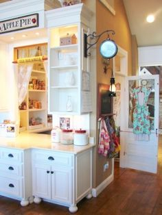 Sugar Pie Farmhouse love pantry in center of room with pass through window and screen door