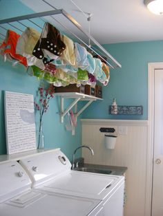 ceiling mount drying rack. Pinning because this picture has a lot of great ideas for my laundry room :)