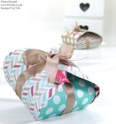 """Wrapped Box ~ ingenious: a handmade 3-inch box, surrounded by Oval Framelits and wound all around with ribbon. Another fabulous project by Pootles aka Sam Donald of Stampin' Up! UK. For box, start with a 5-inch square, score all sides at 1"""". Score oval die-cuts on one end at 1"""" also."""