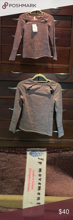 NWT! Free people movement, cut out terry top. M Color is heather rose I'm assuming. Has cut outs on front and back shoulders. Style is cut out terry top. Runs small, tag says M. Brand new, with tags. If not sold this weekend, returning to store. Didn't fit. The only one they had. Sz S-M Free People Tops