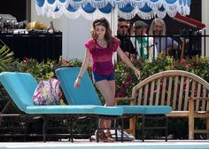 Sarah Hyland Poolside in Navy Blue Shorts on the set of  Modern Family