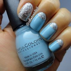 "This pretty baby blue color is ""sugar rush"" from sinful colors professional. The silver glitter is ""queen of beauty"" also from sinful colors. ✴ ✴ #moonmani  #sinfulcolors #selinasnailart"