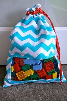 Peek-a-Boo Drawstring Toy Bag. Would be great for our 1000 wooden train tracks.