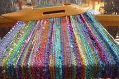 Barefootweaver: Monet's Garden Scarf >>I don't have a weaving board, so pinning this to my knitting board for safe keeping.