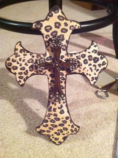 """Wooden cross with leopard print background and gold rhinestone cross layered. Approximately 7.5x11"""". $22.00, via Etsy."""