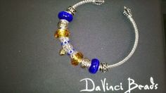 I love these  DaVinci bracelets and how I can personalize them...and at 7 bucks a charm I dont break my bank!!!Ann Crittenden Hallmark Four Seasons.