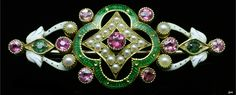 Jubilee enamel brooch. United Kingdom, 1887, tourmaline, seed pearl, green formic roche enamel, white enamel, 18k gold, 1,9cm × 4,5cm, weight 8,7g. Made to celebrate the 50th anniversary of the accession of Queen Vitoria.