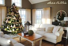 Wall color is Sparrow by Benjamin Moore. Love the white furniture, dark walls, tree decorations with photos, and the pillows! Oh, and the curtains.