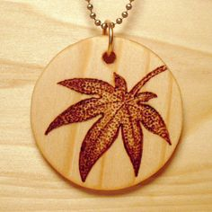 Japanese Maple Leaf Pyrography Wooden Pendant with Ball Chain. $25.00, via Etsy.