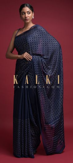 Buy Online from the link below. We ship worldwide (Free Shipping over US$100)  Click Anywhere to Tag Space Blue Saree In Chiffon Blend With Badla Embellished Checks Pattern Online - Kalki Fashion Space blue saree in chiffon blend.Enhanced with badla embellished checks pattern.Trimmed with tassels on the pallu.