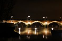 28th of January - Bordeaux(France) : Oldest bridge of Bordeaux, Pont de Pierre, reflection in the Garonne river in the middle of winter
