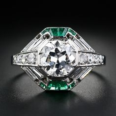 This sensational Art Deco diamond ring, dating from France, presents geometry raised to a new art form. A high-caliber carat European-cut diamond sparkles brightly atop a layered octagonal setting. The beautiful bright white center diamond Art Deco Diamond Rings, Art Deco Ring, Art Deco Jewelry, Fine Jewelry, Jewellery, Diamond Jewelry, Antique Rings, Antique Jewelry, Vintage Jewelry