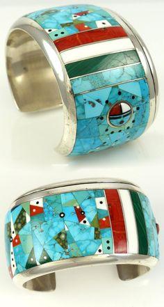 Bracelet   Jesse Monongye (Navajo). Sterling silver with mosaic inlaid Kingman turquoise, Damele turquoise, Mediterranean coral, jet malachite and dolomite.