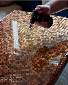 penny table.. shine created by pouring self leveling bar epoxy over top.. wonder if this would work for a floor?