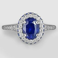 Platinum Sapphire Circa Diamond Ring with Sapphire Accents // Set with a 8x6mm Oval Blue Sapphire #BrilliantEarth
