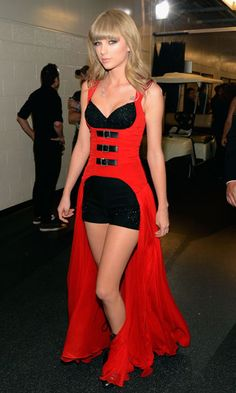 I would wear the corset top with black fitted pants and boots personally. It would be stunning.