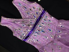 Beautiful tear drops of sparkle cover the body of this design... The purples are rich and bring an elegance to the ice. Perfect for a classic program with a modern twist.