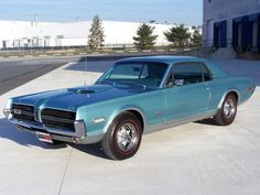 1968 Mercury Cougar GTE.....Somehow they managed to cram a 427 into this thing. One of the rarer cars you might run into- This looks exactly like the cougar I had for my first car! So sad I sold it for a mini van!! :(