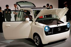 Back to the Future    Honda's EV-N is a tiny retro-looking electric vehicle with a power-producing solar panel on its roof. The car also has a