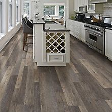 Allure ISOCORE is the latest innovation in vinyl flooring, available exclusively at The Home Depot. Allure ISOCORE Multi-Width Plank Flooring features an innovative highly engineered closed-cell foamed PVC core that delivers rigidity and strength, yet is lightweight and easy to handle and install. Three interchangeable plank widths give you the ability to create a truly custom, authentic wood look floor, and the simple drop-and-lock end joints make installation a breeze. A solid virgin vinyl…