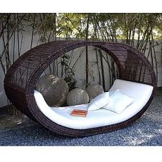 Sampan Outdoor Wicker Day Bed $8495. The price is ridiculous but the bed is pretty sweet.