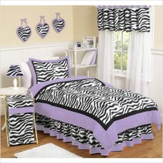 Purple zebra bedding - How funky! Cool black and white accessories for girls of all ages.Discover more kids room decorating and organizing tips and ideas @ http://kidsroomdecorating.net