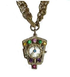 Check out this item in my Etsy shop https://www.etsy.com/ca/listing/264873397/vintage-clock-locket-charm-bracelet