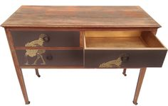 Antique Ostrich Chest. Antique mahogany chest upcycled with stunning Ostrich wallpaper. http://www.themintlist.com/product/antique-ostrich-chest