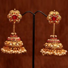 Anvi's designer bridal jhumkas with pearls and rubies