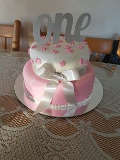birthday cake for pink, white and silver themed 1st birthday