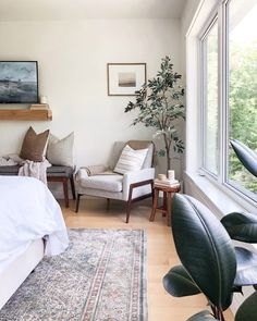 Create a cozy reading nook in your primary bedroom as a corner to cozy up and escape to. Use layers like throw blankets and pillows to bring warmth. Home Bedroom, Bedroom Decor, Master Bedroom, Bedrooms, Bedroom Reading Nooks, Bedroom Fireplace, Interior Inspiration, Bedroom Inspiration, Dream Decor