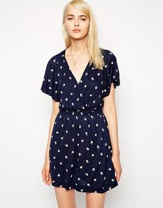 I own a similar dress to this by French Connection.  I love it except for the large arm holes!