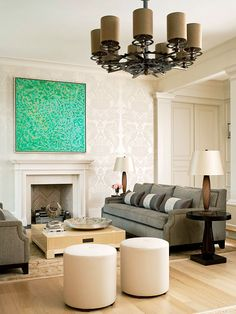 The simplicity of modern style can leave room for softer decorating touches, such as the traditional pattern in this living room wallpaper. The tone-on-tone color keeps the ornate pattern subtle enough to blend with contemporary furnishings, while its classic design playfully contrasts the graphic wall art./