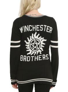 <p>Black knit cardigan from <i>Supernatural</i> with embroidered logo on front and intarsia knit design on back.</p>  <ul> <li>52% cotton; 48% acrylic</li> <li>Wash cold; dry low</li> <li>Imported</li> <li>Listed in junior sizes</li> </ul>