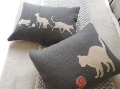 hand printed charcoal cat cushion by helkatdesign on Etsy