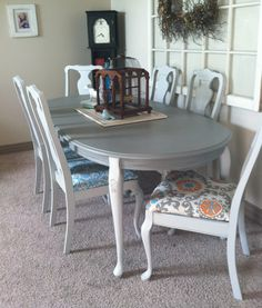 Dining table redo grey... Absolutely love the different colored upholstered chairs!!!