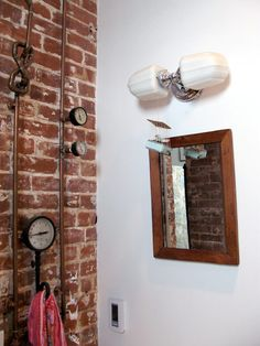 salvaged dials and gauges, creative copper pipes, and what is that little thing hanging from the light fixture??? I love it! So whimsical
